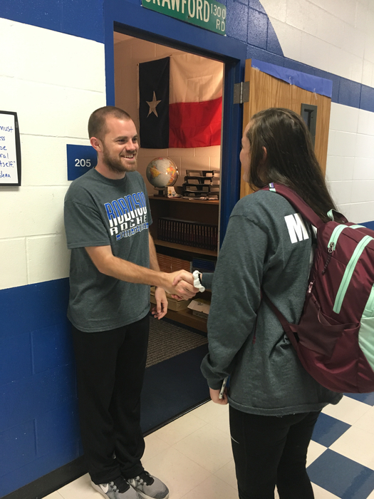 Coach Crawford greeting every single student with a handshake and a smile!